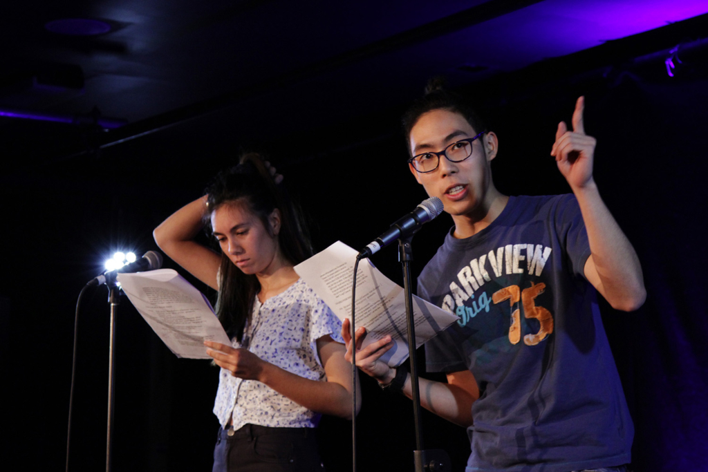 Emily Campbell and Bhavudhi (Punn) Roongnirandon reading Insomnia by Nikorn Sae Tang. Photo by Michael McCabe
