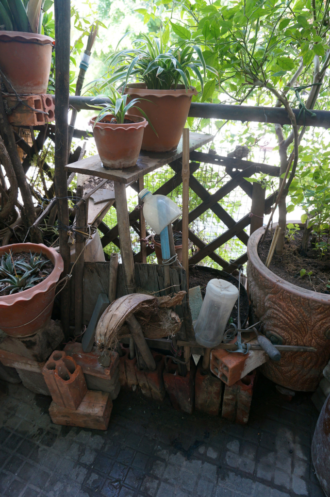 Balcony garden with shelving made from brick and trellis support, Phnom Penh, Cambodia, 2014. Photo by Xin Cheng